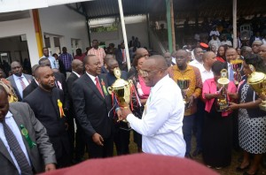 The NSSF Chairman Gideon Ndambuki receiving the number one trophy for the best Government Services
