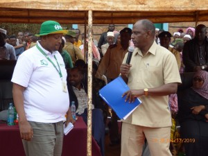 Labour C.S Amb. Ukur Yatani with NSSF Branch Manager in Wajir County during the Labour Ministry outreach programme on Social Security.